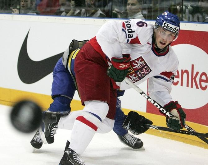 Томаш Мойжиш -- первый действующий чемпион мира в составе