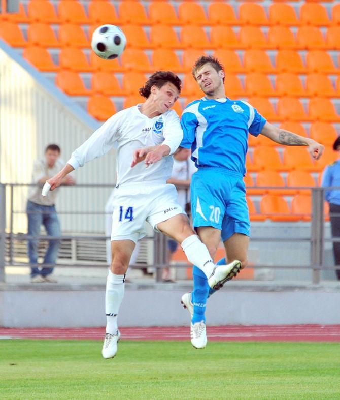 Дмитрий Турлин (на фото слева) был грозен в матче с албанцами