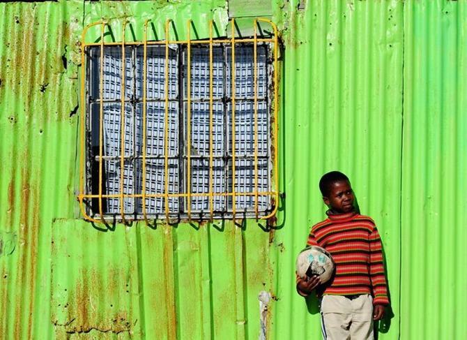 Один из южноафриканских районов трущоб.